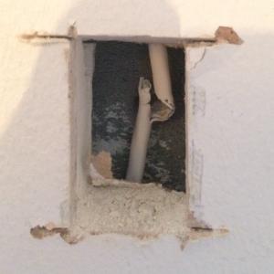 Hutton handyman repairing broken cables